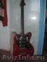 электро-гитара торнадо